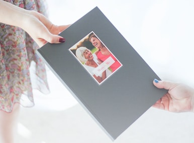 handing a photobook with deboss cover from generation to generation